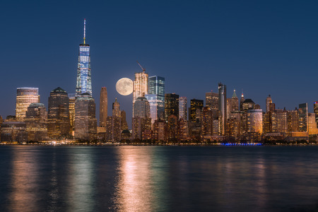 moon  metropolis: Perigee full moon over the skyscrapers of lower Manhattan-New York