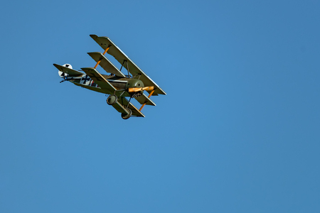 RHINEBECK, NY - SEPTEMBER 25, 2016: The Aerodrome Air Show Team perform a show with the  World War I plane Curtiss JN-4H (Original) at Old Rhinebeck Aerodrome