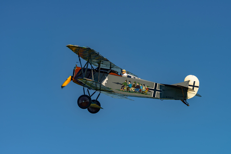 RHINEBECK, NY - SEPTEMBER 25, 2016: The Aerodrome Air Show Team perform a show with the  World War I plane Fokker D.VII (Reproduction) at Old Rhinebeck Aerodrome Stock Photo