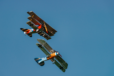 RHINEBECK, NY - SEPTEMBER 25, 2016: The Aerodrome Air Show Team perform a show with the  World War I plane Albatros D.Va (Reproduction) Fokker Dr-I  at Old Rhinebeck Aerodrome