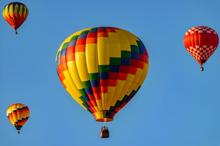 Colorful hot air balloons against blue sky Reklamní fotografie