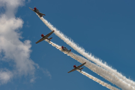 windsor: NEW WINDSOR, NY - JULY 2, 2017: The GEICO Skytypers Air Show Team perform at the New York Airshow at Stewart Int Airport. SNJ-2 World War II era planes fly in formation.