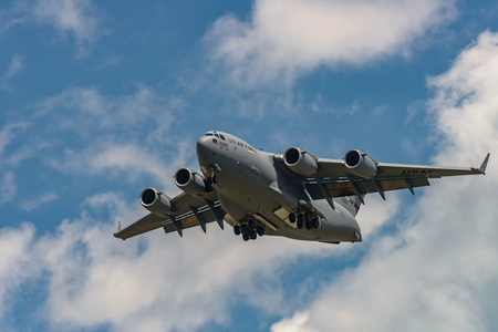 NEW WINDSOR, NY - JULY 2, 2017: Giant C-17 Globemaster III taking off at Stewart International Airport during the New York Airshow. Editorial
