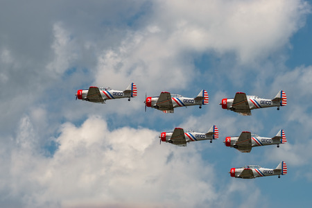 NEW WINDSOR, NY - JULY 2, 2017: The GEICO Skytypers Air Show Team perform at the New York Airshow at Stewart Int Airport. SNJ-2 World War II era planes fly in formation.