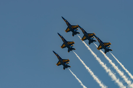windsor: NEW WINDSOR, NY - JULY 2, 2017: U.S.NAVY Blue Angles perform at the Stewart International Airport during the New York Airshow. Squadron is the official air demonstration team for the United States Air Force