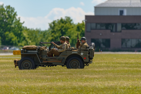 READING, PA - JUNE 3, 2017: World War II reenactment of a battle between American infantryman and German soldiers at Mid-Atlantic Air Museum World War II Weekend and Reenactment Editorial