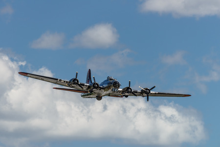 READING, PA - JUNE 3, 2017: Boening B-17G Flying Fortress Yankee Lady in flight during World War II reenactment at Mid-Atlantic Air Museum