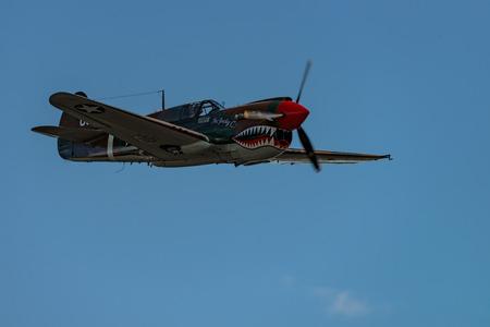 READING, PA - JUNE 3, 2017: Curtiss P-40M WARHAWK in flight during World War II reenactment at Mid-Atlantic Air Museum