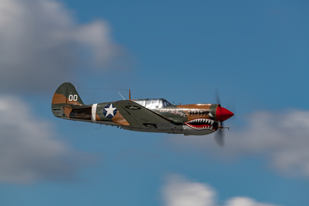 READING, PA - JUNE 2, 2018: Curtiss P-40M WARHAWK in flight during World War II reenactment at Mid-Atlantic Air Museum Editöryel
