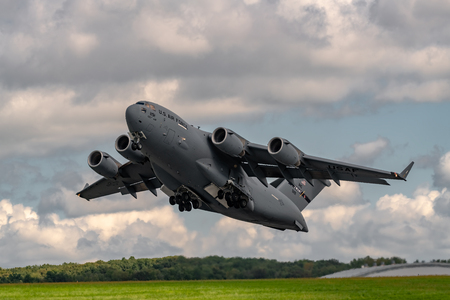 NEW WINDSOR, NY - SEPTEMBER 15, 2018: Giant C-17 Globemaster III taking off at Stewart International Airport during the New York Airshow.
