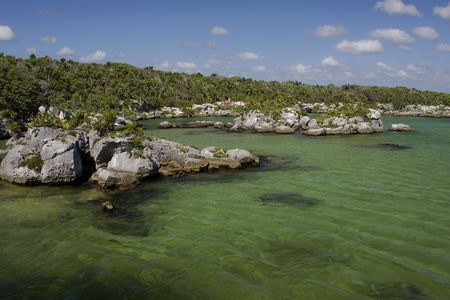 image of the lagoon at Xel-Ha in Mexico showing green colored water Stock Photo