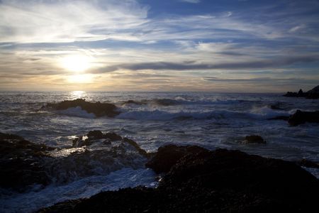 Sunset over the ocean in Point Lobos State Natural Reserve in California Stock Photo