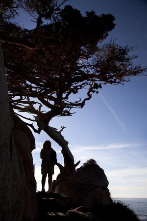 Hiker silhouetted at Sunset at Point Lobos State Natural Preserve