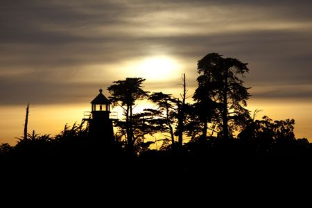 abbott: Mark Abbott Memorial Lighthouse silhouetted at sunset