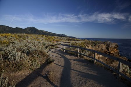 Hicking trail along the coast in Point Lobos State Natural Reserve in Carmel California Stock Photo