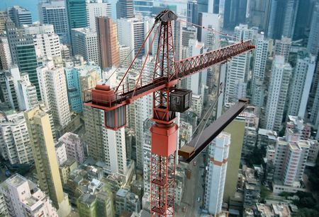 View of a construction crane from above looking down onto a metropolitain city scape during daytime photo