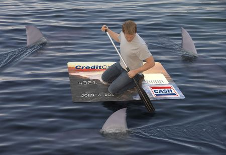 Man stranded on a raft made of a huge credit card in the ocean while being circled by sharks Reklamní fotografie