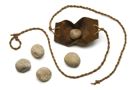 david and goliath: Sling and five smooth stones used by David to kill Goliath on a white background