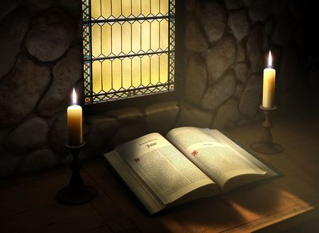 old desk: Open Bible flanked with two candles near a sunlit stained glass window in an old monestery Stock Photo