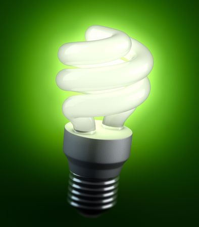 An energy saving lightbulb shinging green light photo