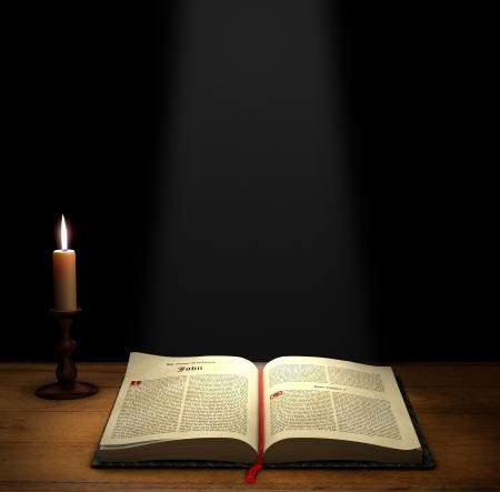 historias biblicas: Biblia abierta en una tabla con una vela con espacio de copia anterior