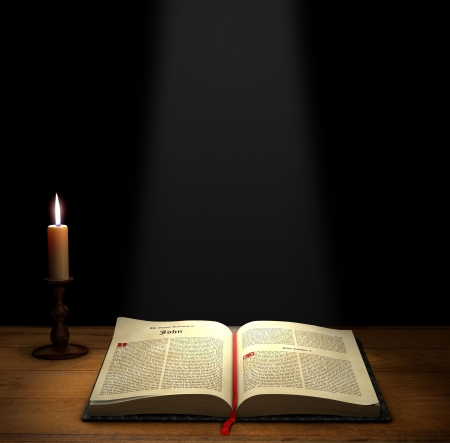 methodist: Open Bible on a table with a candle with copy space above