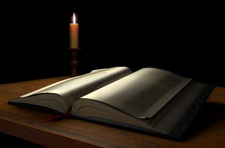 An open book on a dark background illuminated with a candle Stock Photo - 7038104