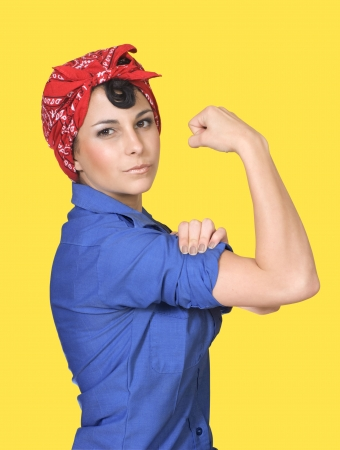 Classic World War II poster featuring Rosie the Riveter flexing her arm muscles against a yellow background. Stock Photo - 7039713