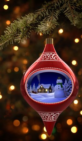christmas cabin: Christmas ornament featuiring a diorama of a snowman and cabin Stock Photo