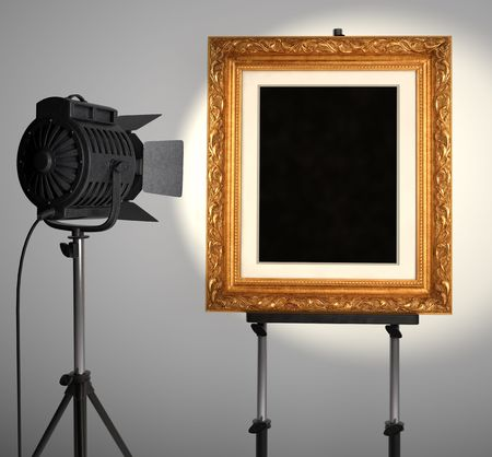 A spotlight lighting up a blank picture frame photo