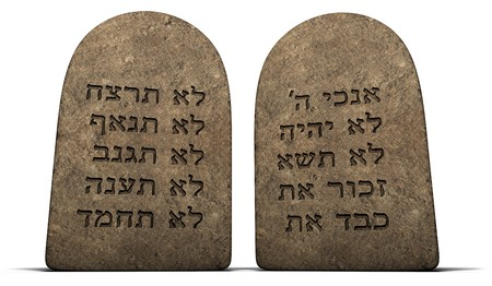 Ten Commandments on stone tablets isolated on a white background