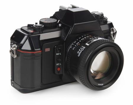 35mm SLR camera isolated on white  photo