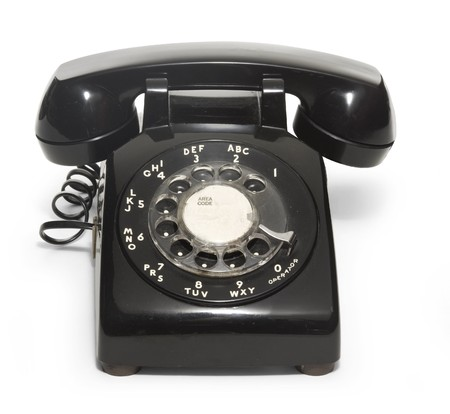 rotary dial telephone: Black 1950s telephone on a white background