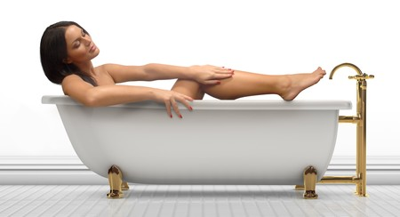 bathtubs: Young woman in an antique bathtub on a white background Stock Photo