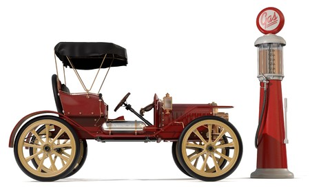 1910 style antique car and gas pump photo