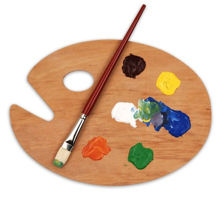 wooden art palette with blobs of paint and a brush on white background photo