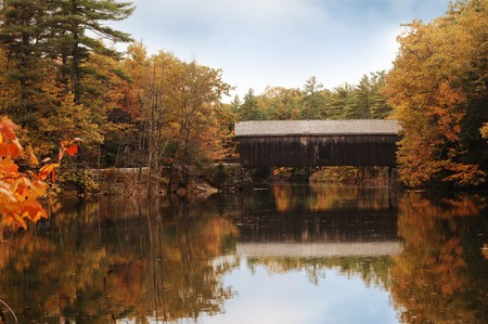 covered bridge in Maine during fall colors photo