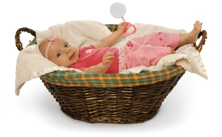 Cute baby in a basket on a white background photo