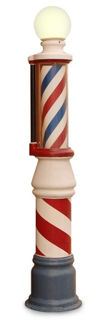 Free standing vintage barber pole on a white background photo