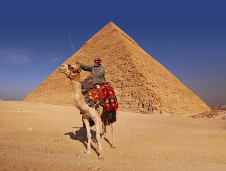 Bedouin and camel in front of the Great Pyramid at Giza photo