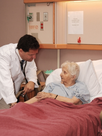 doctor taking senior blood pressure