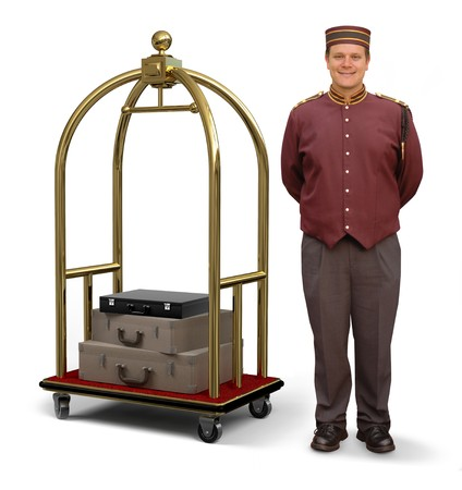 Bellhop in retro uniform and luggage cart on a white background  Stok Fotoğraf
