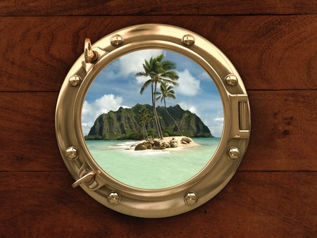 ship porthole: Porthole inside a ship with a view of a deserted island Stock Photo
