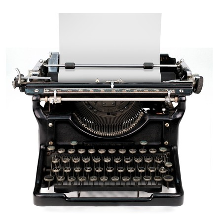 old fashioned: old fashioned, vintage typewriter isolated on white background with a blank sheet of paper inserted