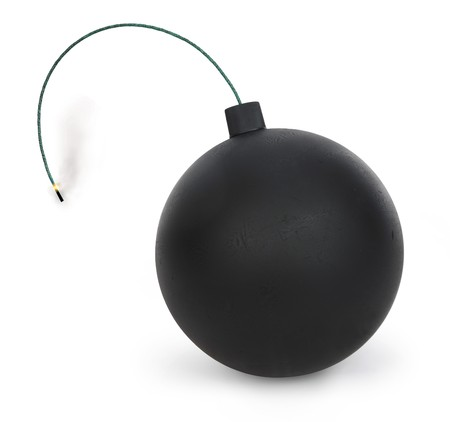 round bomb with lit fuse on white background