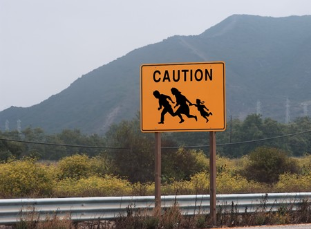 ins: highway sign showing family crossing Stock Photo