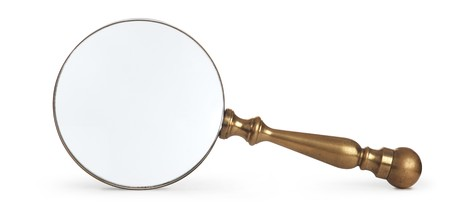 nosey: antique brass magnifying glass on white background
