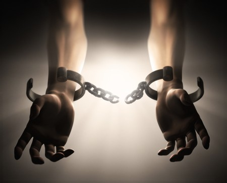 ball and chain: A Dramatic scene showing manicals breaking off a mans hands Stock Photo