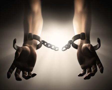 esclavo: Una dram�tica escena mostrando manicals romper un mans manos  Foto de archivo