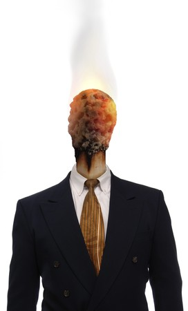 Burnt matchhead emerging from the collar of a business suit where a man's head should be